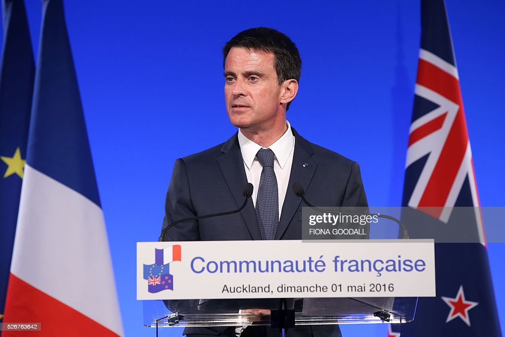 French Prime Minister Manuel Valls speaks before presenting Peter Jackson and Fiona Pardington with a Ordre des Arts et des Lettres medal at a French community event at the Auckland War Memorial Museum on May 1, 2016. / AFP / Fiona Goodall