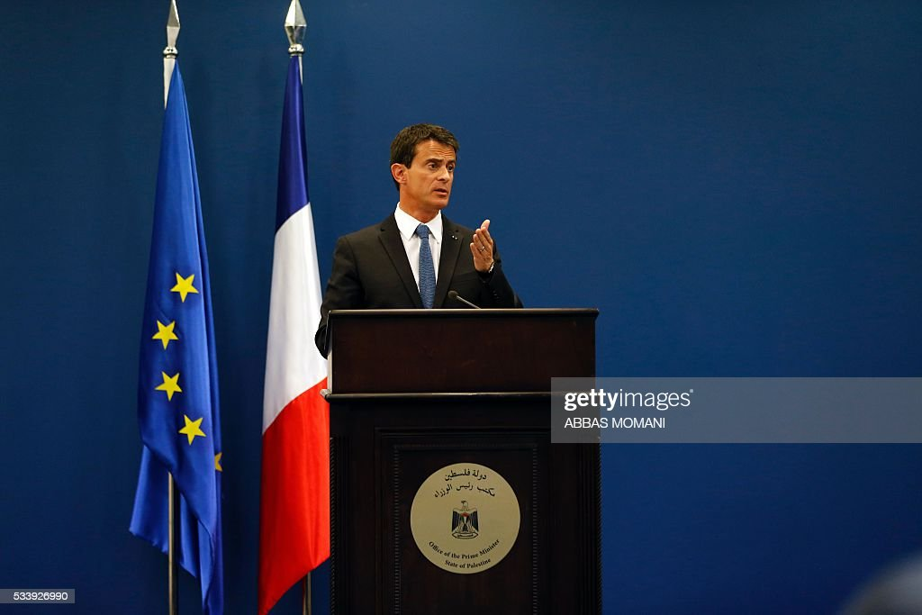 French Prime Minister Manuel Valls speaks during a press conference with Palestinian prime minister in the West Bank city of Ramallah, on May 24, 2016. Palestinian prime minister Rami Hamdallah dismissed an Israeli proposal for direct negotiations instead of a French multilateral peace initiative, calling it an attempt to 'buy time'. / AFP / ABBAS