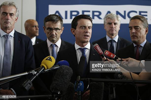 French Prime minister Manuel Valls speaks to the press beside Air FranceKLM's Chairman and Chief Executive Officer Alexandre de Juniac Air France...