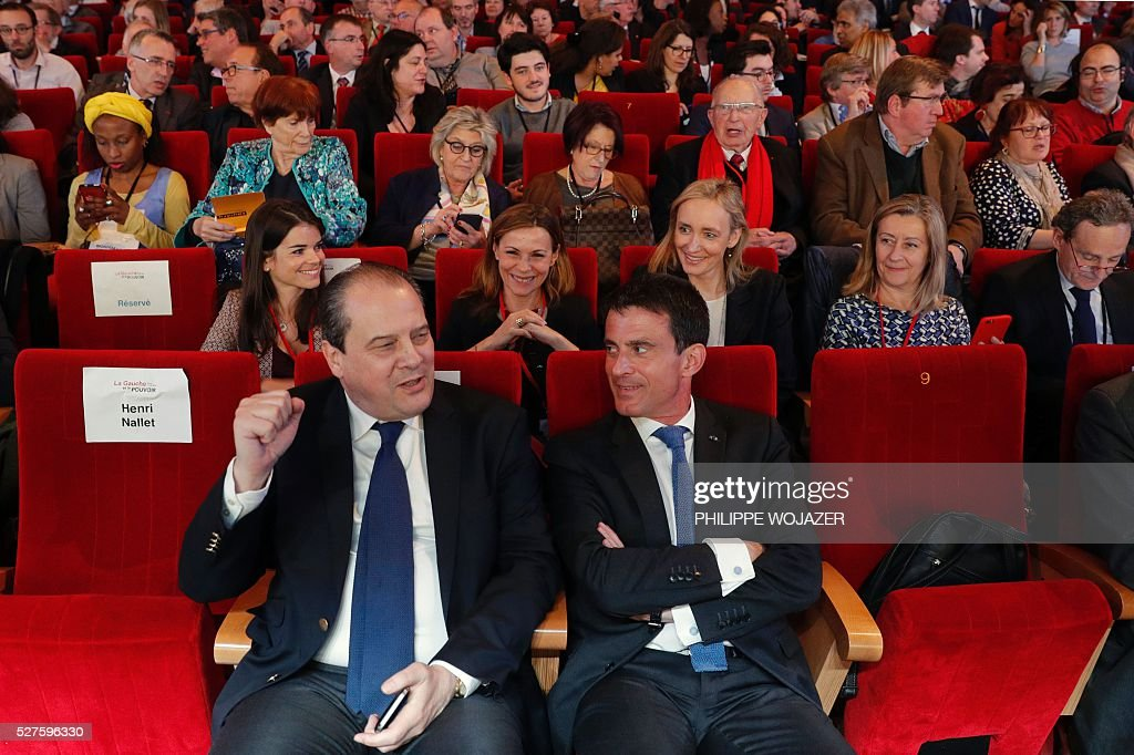 French Prime Minister Manuel Valls (R) speaks with Socialist Party (PS) First Secretary Jean-Christophe Cambadelis (L) during the conference 'Left wing and Power' at the Jean-Jaures Foundation in Paris, on May 3, 2016. Hollande defended on May 3 his government's labour reforms law as a 'text of progress', few hours before its examination by the parliament, adding he sees it as a 'dynamic and fair compromise'. / AFP / POOL / PHILIPPE