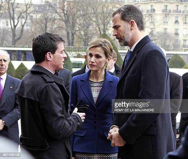 French Prime Minister Manuel Valls speaks with Spain's King Felipe VI and Spain's Queen Letizia prior to a ceremony at the Hotel des Invalides in...