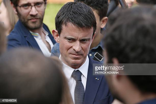 French Prime Minister Manuel Valls talks on April 17 2015 with students of the Leon Blum high school in Creteil southeastern Paris suburb before the...