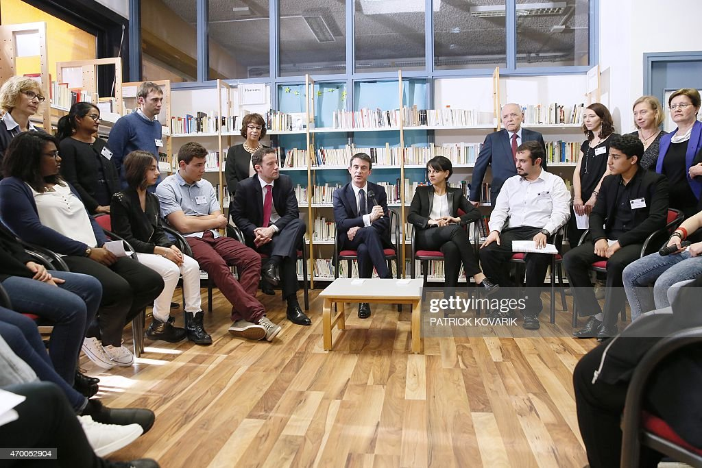 French Prime Minister <a gi-track='captionPersonalityLinkClicked' href=/galleries/search?phrase=Manuel+Valls&family=editorial&specificpeople=2178864 ng-click='$event.stopPropagation()'>Manuel Valls</a> (L) talks to students and teachers during a visit with Education minister <a gi-track='captionPersonalityLinkClicked' href=/galleries/search?phrase=Najat+Vallaud-Belkacem&family=editorial&specificpeople=4115928 ng-click='$event.stopPropagation()'>Najat Vallaud-Belkacem</a> of the Leon Blum high school in Creteil, south-eastern Paris suburb, on April 17, 2015, before the presentation of the government's plan aimed at figthting Racism and anti-Semitism. AFP PHOTO / PATRICK KOVARIK