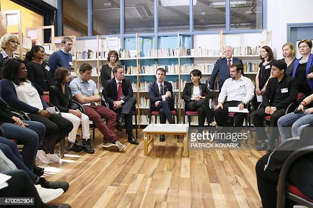 French Prime Minister Manuel Valls talks to students and teachers during a visit with Education minister Najat VallaudBelkacem of the Leon Blum high...