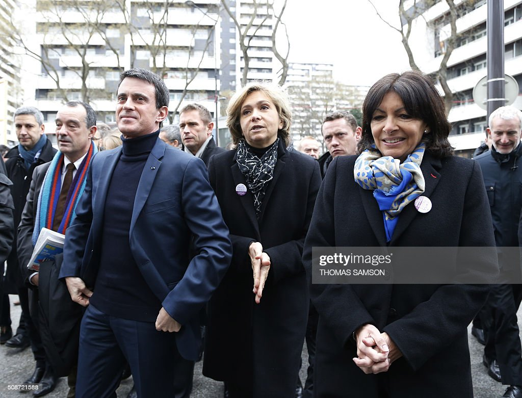 French Prime minister Manuel Valls, the President of the regional council of the Ile-de-France region Valerie Pecresse and Mayor of Paris Anne Hidalgo attend the inauguration of the new Rosa Parks railway station in Paris on February 6, 2016. / AFP / THOMAS SAMSON