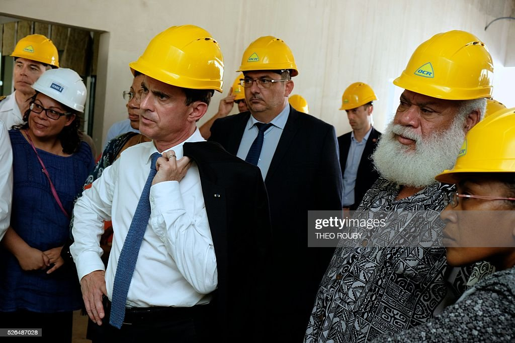 French Prime minister Manuel Valls (foreground L) visit the Northern hospital complex building site with president of the North Province of New Caledonia Paul Neaoutyine (2ndR) in Kone, on April 30, 2016, as part of his visit to the French Pacific territory. The visit comes amid political tension about New Caledonia's future and economic uncertainty following the sharp drop in the price of nickel. With the territory bound to have an independence referendum by 2018, Manuel Valls called on the territory's leaders not to waste time in useless skirmishes. / AFP / Th��o Rouby