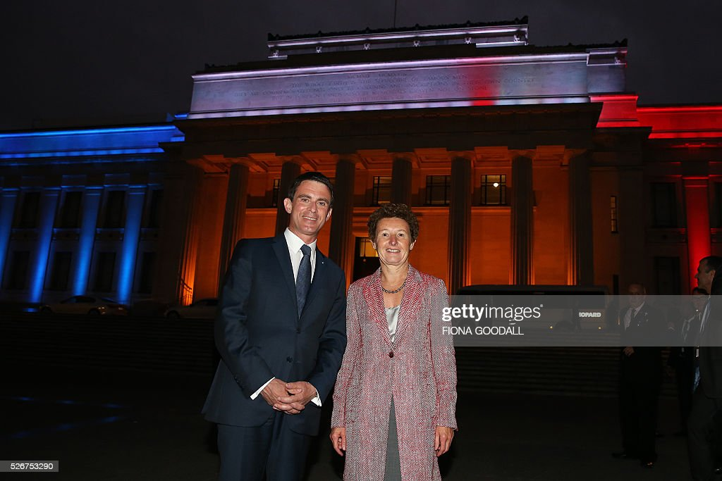French Prime Minister Manuel Valls (L) visits Auckland War Memorial Museum with French Ambassador Florence Jeanblanc-Risler (R), ahead of a French community event on May 1, 2016. / AFP / Fiona Goodall