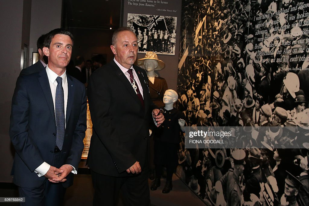 French Prime Minister Manuel Valls (L) visits Auckland War Memorial Museum with museum protocol co-ordinator Lance Richmond (R), ahead of a French community event on May 1, 2016. / AFP / Fiona Goodall
