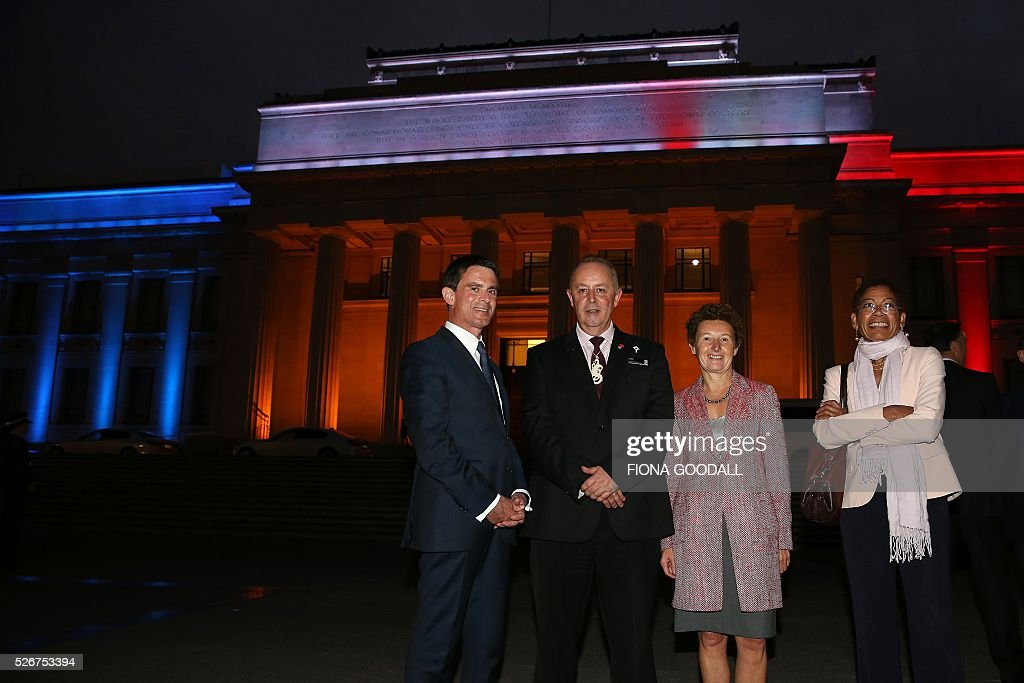 French Prime Minister Manuel Valls (L) visits Auckland War Memorial Museum with NZ French Ambassador Florence Jeanblanc-Risler (CR), George Pau-Langvin, Minister of French Overseas Territories (R) and Auckland Museum protocol co-ordinator Lance Richmond (CL), ahead of a French community event on May 1, 2016. / AFP / Fiona Goodall