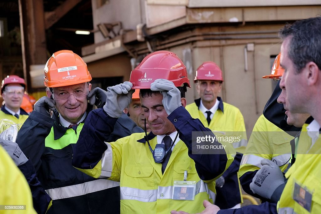 French Prime Minister Manuel Valls visits metallurgic factory SLN in Noumea on April 29, 2016. Valls said France would be willing to loan 200 millions euros to save the SLN factory, the main producer of nickel in New Caledonia. / AFP / THEO