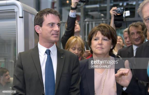 French Prime Minister Manuel Valls visits on March 18 2015 with the mayor of the northern French city of Lille Martine Aubry the EuraTechnologies...