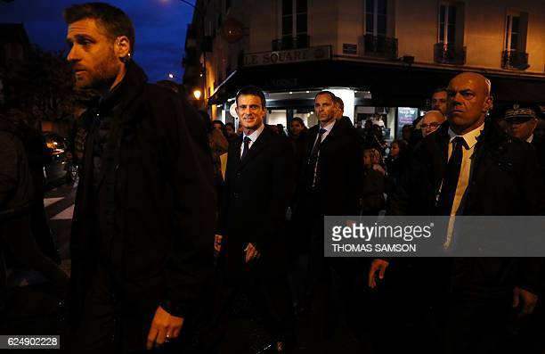 French Prime Minister Manuel Valls walks to the City Hall of Alfortville after inaugurating the city's municipal police station on November 21 2016 /...