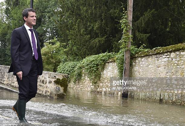 French Prime Minister Manuel Valls wearing boots visits flooded areas in Crosne on June 4 2016 in a southern Paris' suburb The rainswollen River...