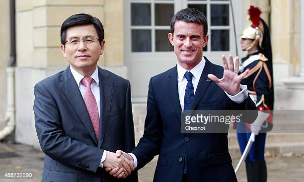 French Prime Minister Manuel Valls welcomes KyoAhn Hwang Korea's Prime Minister prior to their meeting at Matignon on September 17 in Paris France...