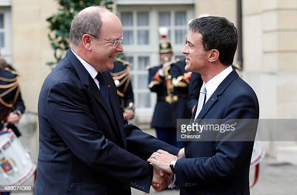 French Prime Minister Manuel Valls welcomes Prince Albert II of Monaco at the Hotel de Matignon on September 19 2015 in Paris France Prince Albert II...