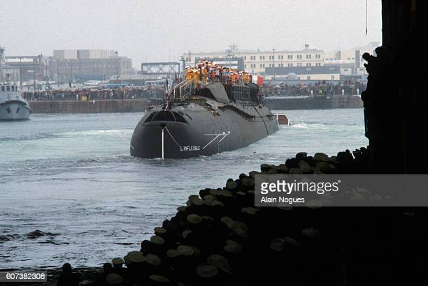 French Prime Minister Pierre Mauroy and Minister of Defense Charles Hernu are among the crowd watching the 1982 launch of the nuclear submarine...