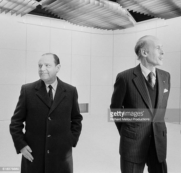 French prime minister Raymond Barre stands with President Valery Giscard d'Estaing