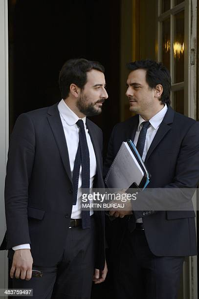 French Prime Minister's communication adviser Harold Hauzy and cabinet director Sebastien Gros confer at the Hotel Matignon on April 10 2014 in Paris...