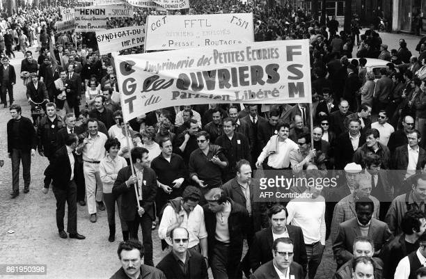 French printing works employees of the newspaper 'Le Parisien libéré' take part in the big demonstration called by the CGT and CFDT unions in Paris...