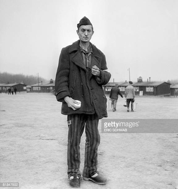 French prisoner and journalist Christian Ozanne stands in the courtyard of Buchenwald camp in April 1945 after it was liberated by the US army The...