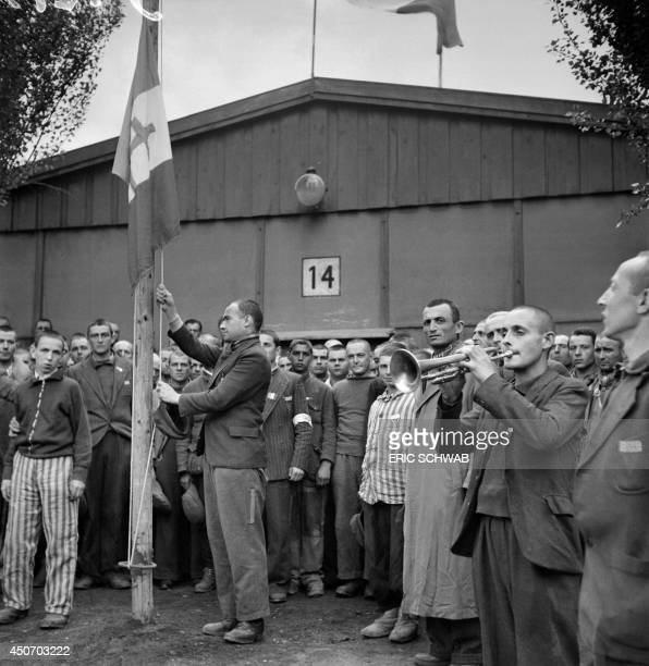 French prisoners sing the national anthem 'La Marseillaise' in late April or early May 1945 after the camp was liberated by the US army on April 29...