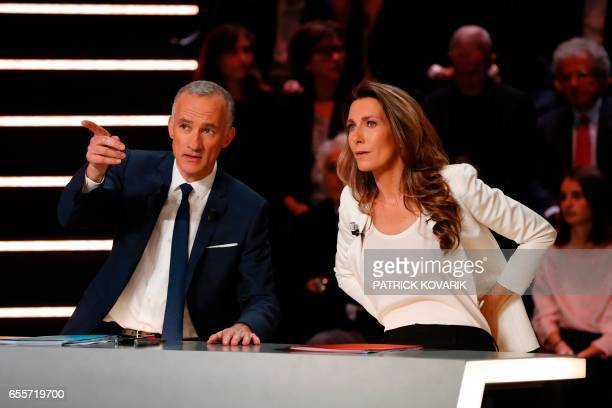 French private TV channel TF1 journalists Gilles Bouleau and AnneClaire Coudray speak before a debate between five candidates for the French...