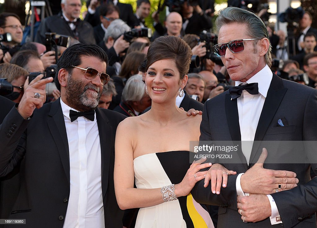French producer Alain Attal, French actress Marion Cotillard and US tattoo artist and actor Mark Mahoney arrive on May 20, 2013 for the screening of the film 'Blood Ties' presented Out of Competition at the 66th edition of the Cannes Film Festival in Cannes. Cannes, one of the world's top film festivals, opened on May 15 and will climax on May 26 with awards selected by a jury headed this year by Hollywood legend Steven Spielberg.
