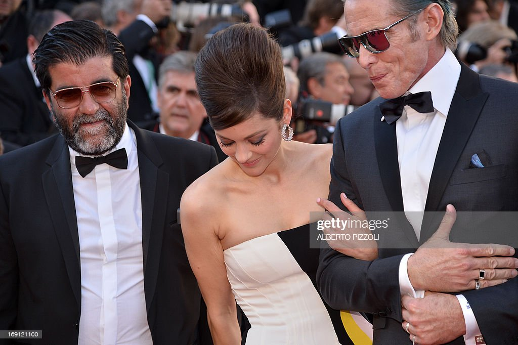 French producer Alain Attal, French actress Marion Cotillard and US tattoo artist and actor Mark Mahoney arrive on May 20, 2013 for the screening of the film 'Blood Ties' presented Out of Competition at the 66th edition of the Cannes Film Festival in Cannes. Cannes, one of the world's top film festivals, opened on May 15 and will climax on May 26 with awards selected by a jury headed this year by Hollywood legend Steven Spielberg. AFP PHOTO / ALBERTO PIZZOLI
