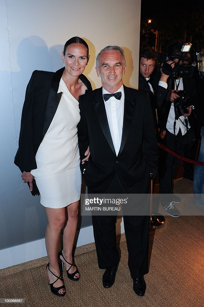 French producer Alain Terzian arrives with his wife, Brune de Margerie, to attend the Figaro Madame/Chanel dinner during the 63rd Cannes Film Festival on May 18, 2010 in Cannes.