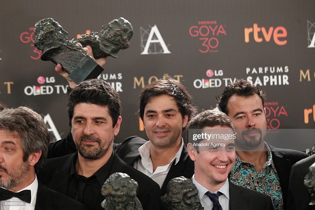 French producer and actor Charles Gillibert (C) poses during a photocall after receiving the Goya award for the best European film for the film ''Mustang'' at the 30th edition of the Goya Awards ceremony in Madrid, Spain on Feburary 6, 2016.