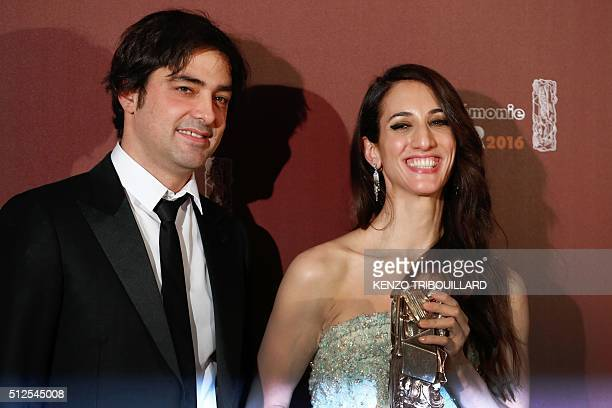 French producer Charles Gillibert and FrenchTurkish director Deniz Gamze Erguven pose with their trophy after they won the Best First Feature Film...