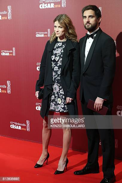 French producer Dimitri Rassam and his wife Masha Novoselova pose as they arrive for the 41st edition of the Cesar Ceremony at the Theatre du...