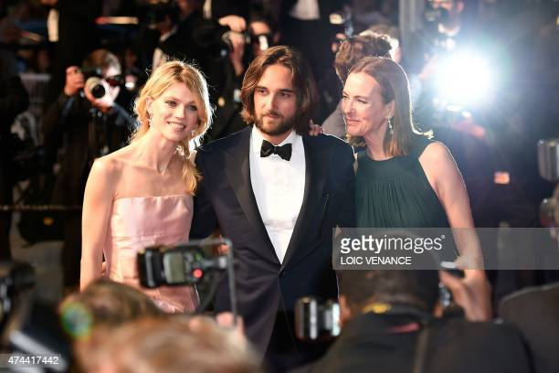 French producer Dimitri Rassam poses with his wife Masha Rassam and mother French actress Carole Bouquet before leaving the Festival palace after the...