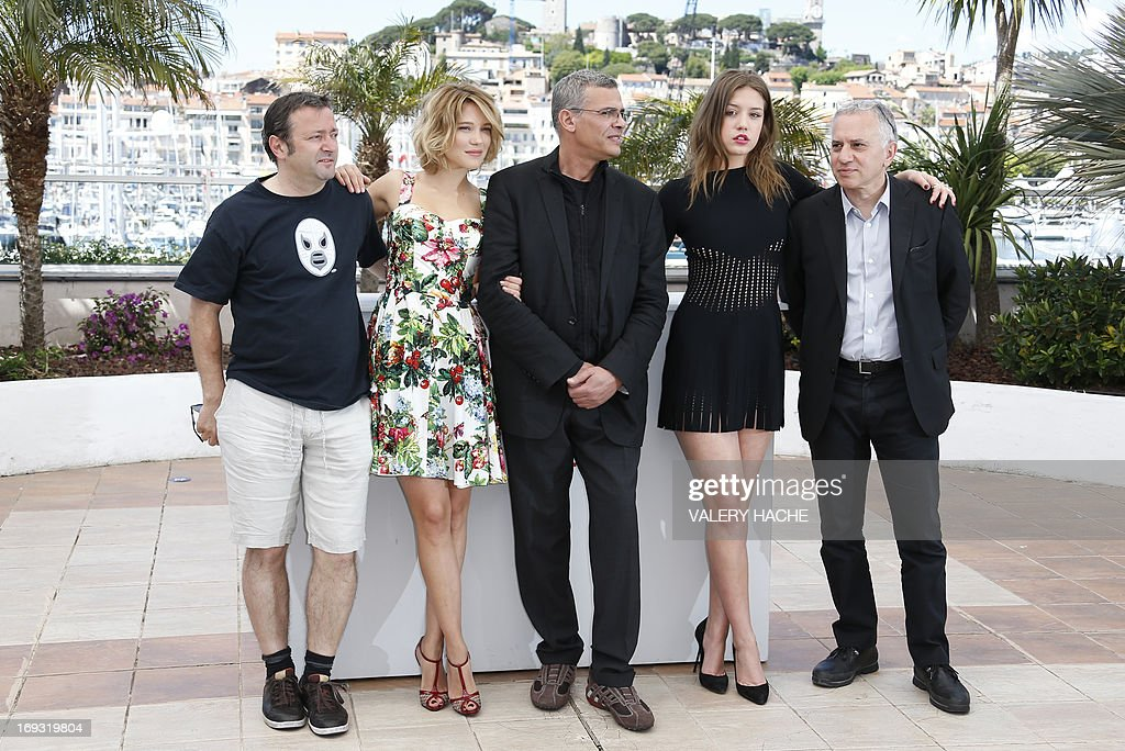 French producer Vincent Maraval, actress Lea Seydoux, French-Tunisian director Abdellatif Kechiche, French actress Adele Exarchopoulos and producer Brahim Chioua pose on May 23, 2013 during a photocall for the film 'Blue is the Warmest Colour' (La Vie d'Adele - Chapitre 1 & 2) presented in Competition at the 66th edition of the Cannes Film Festival in Cannes. Cannes, one of the world's top film festivals, opened on May 15 and will climax on May 26 with awards selected by a jury headed this year by Hollywood legend Steven Spielberg. AFP PHOTO / VALERY HACHE