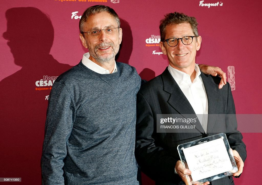 French producers Christophe Rossignon (L) and Philip Boeffard, nominated for Best Feature Film, pose during the nominations event for the 2016 César film awards, on February 6, 2016 in Paris. The 41st Ceremony for the Cesar film award, considered as the highest film honour in France, will take place on February 26, 2016. / AFP / FRANCOIS GUILLOT