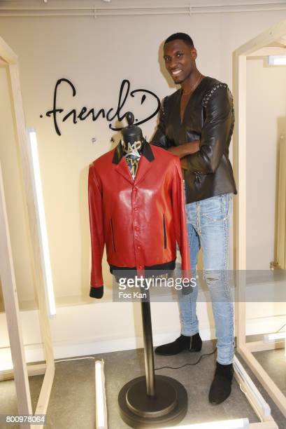 French professional basketball player for the Washington Wizards Ian Manhinmi poses during the French Deal Cocktail as part of Paris Fashion Week on...