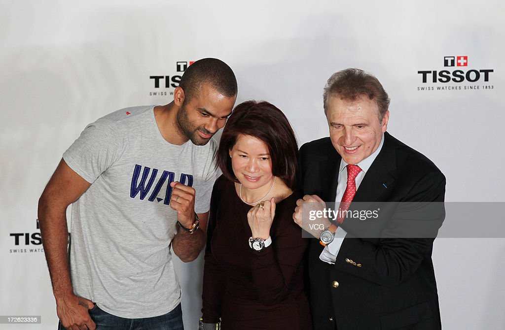 French professional basketball player Tony Parker of the San Antonio Spurs (L) attends commercial event on July 3, 2013 in Beijing, China.