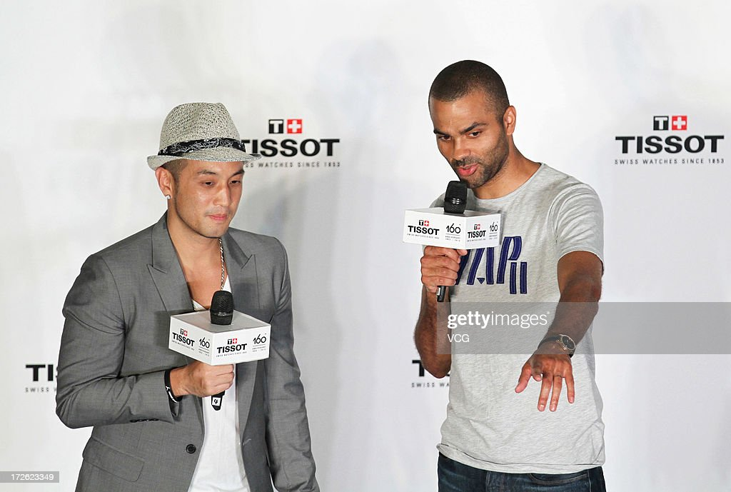 French professional basketball player Tony Parker (R) of the San Antonio Spurs attends commercial event on July 3, 2013 in Beijing, China.