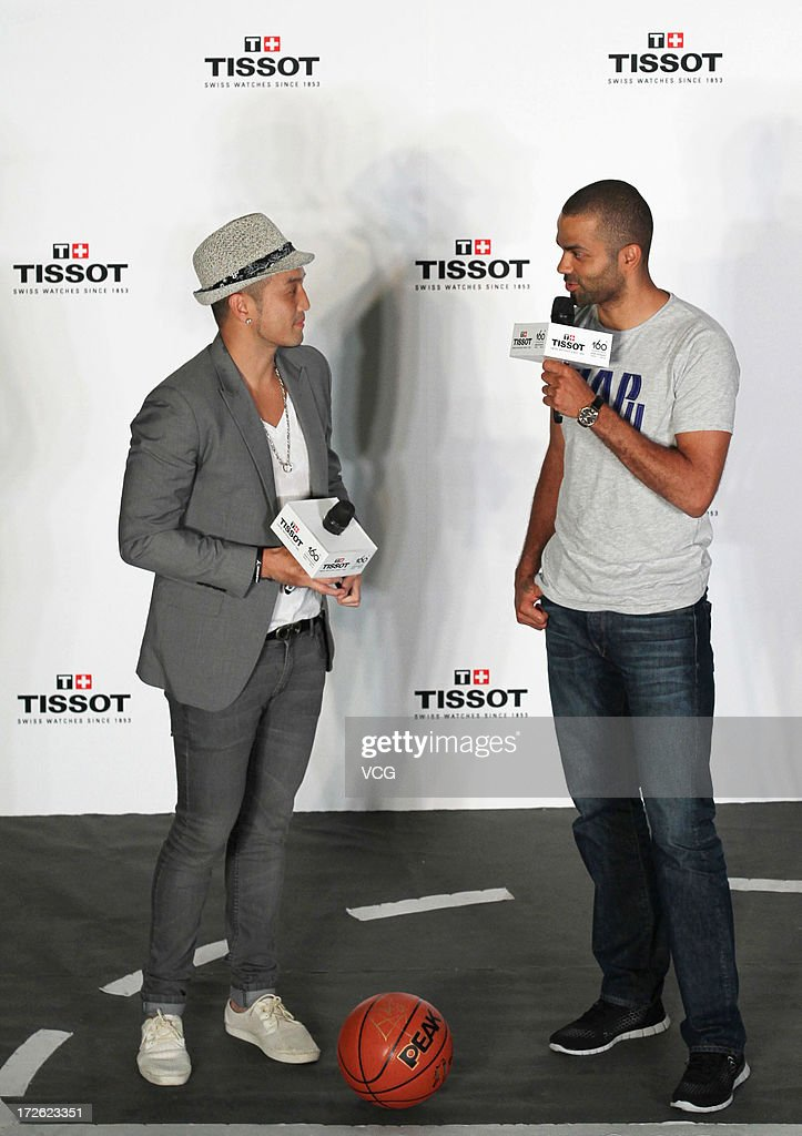 French professional basketball player Tony Parker of the San Antonio Spurs (R) attends commercial event on July 3, 2013 in Beijing, China.
