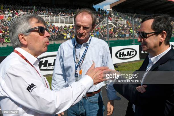 French promoter of the French Motorcycle Grand Prix Claude Michy Swiss honorary IOC member JeanClaude Killy and France's President of the Automobile...