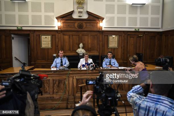 French prosecutor Dietlind Baudoin speaks during a press conference flanked by French gendarmes LieutenantColonel Didier Plunian and Colonel Yves...