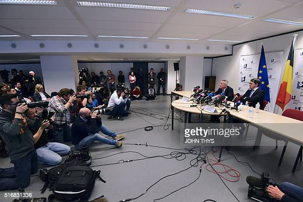 French prosecutor Francois Molins and his Belgian counterpart Frederic Van Leeuw address a press conference in Brussels on March 21 2016 Police have...