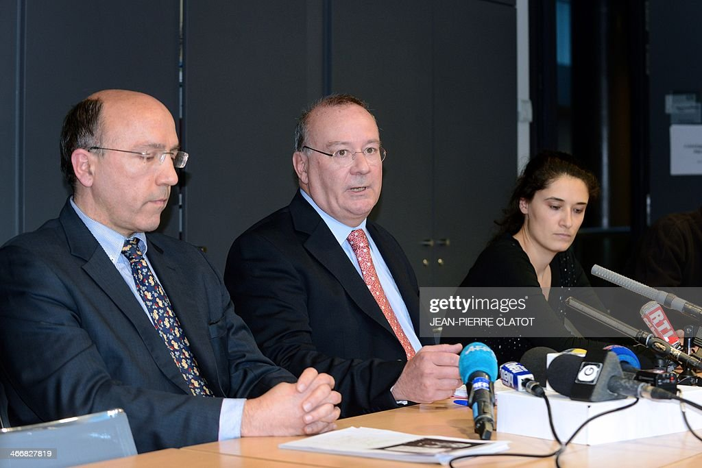 French prosecutor of the city of Grenoble, Jean-Yves Coquillat (C), next to the public security director Patrick Mairesse (L), speaks during a press conference on February 4, 2014 at the Grenoble courthouse, after a handicapped person was assaulted by three minors who recorded videos of the aggression and posted them on the internet. The three suspects, aged 14, 15 and 16, have been arrested and are in custody.