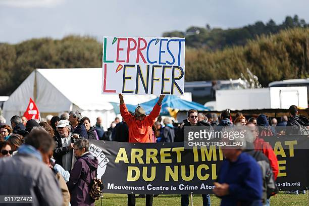 French protester JeanBaptiste Redde aka Voltuan holds a sign reading 'The ERP is hell' during an antinuclear demonstration on October 1 2016 in...