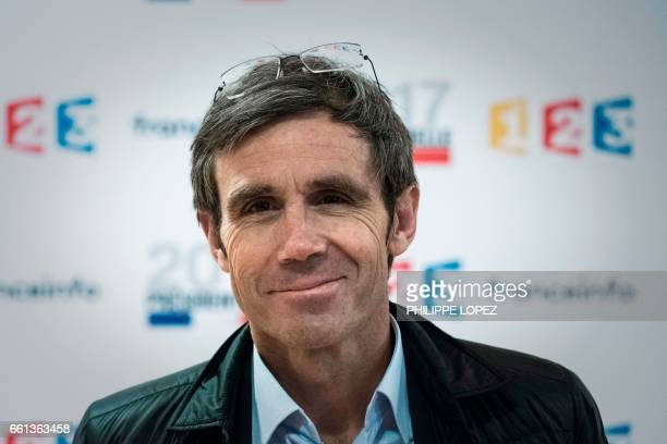 French public broadcaster France Televisions journalist David Pujadas poses at the headquarters of France Televisions in Paris on March 31 2017 / AFP...