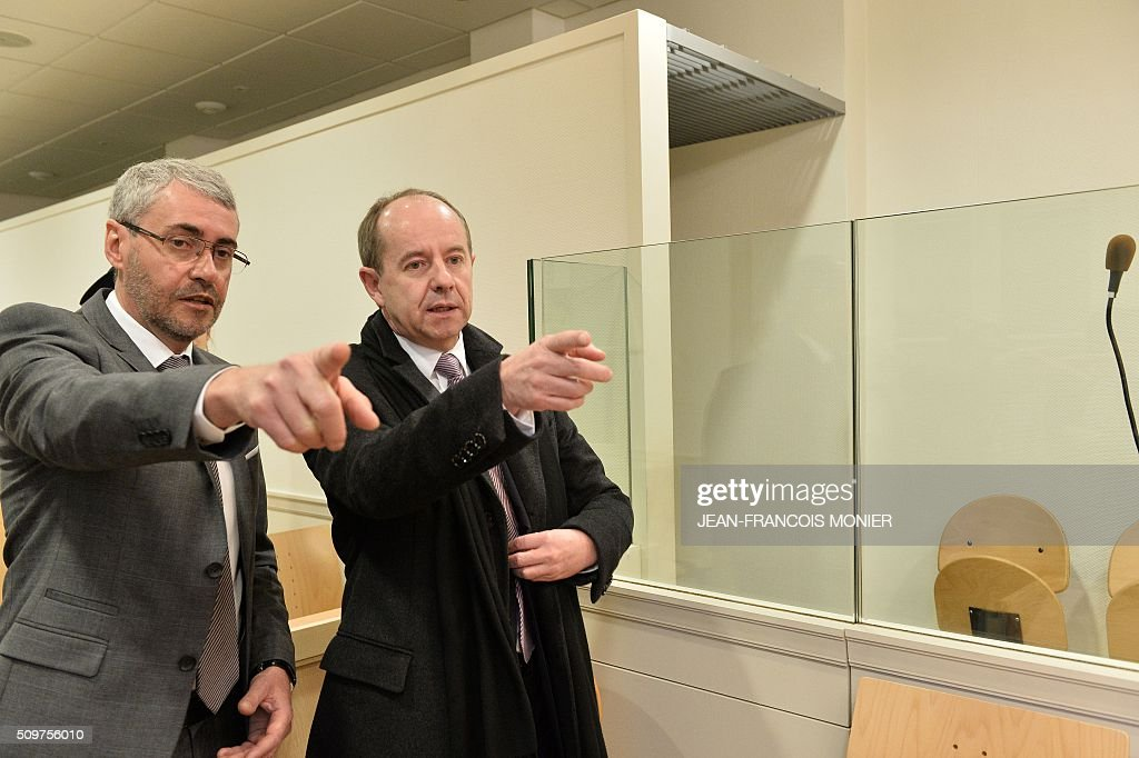 French public prosecutor of Chartres, Patrice Ollivier-Maurel (L) and French Justice Minister Jean-Jacques Urvoas tour a courtroom during Urvoas' visit to the Regional Court (TGI) of Chartres on February 12, 2016. / AFP / JEAN-FRANCOIS MONIER