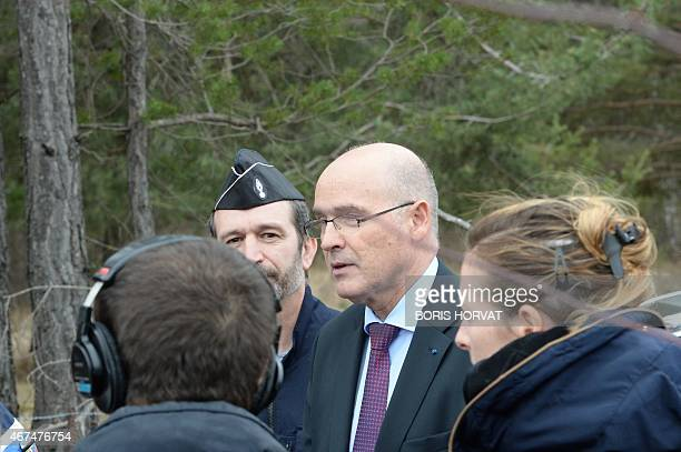 French public prosecutor of Marseille Brice Robin speaks with journalists and gendarmes in SeynelesAlpes southeastern France on March 25 2015 a day...