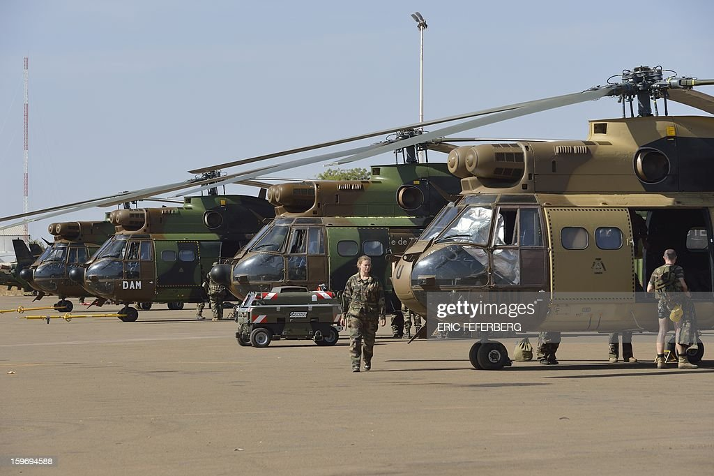 French PUMA helicopters from the 5th RHC (Combat Helicopter Regiment) are parked on the 101 airbase near Bamako on January 18, 2013. France now has 1,800 troops on the ground in Mali, inching closer to the goal of 2,500 it plans to deploy in its African former colony, Defence Minister Jean-Yves Le Drian said today. That was 400 more than a day earlier, said the minister as he met with French special forces in the western port of Lorient. The troops have been sent to help the Malian army regain control of the north from Islamist groups.