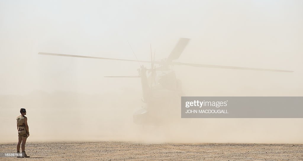 A French Puma transport helicopter lifts dust as it taxies at the airport in Gao on March 9, 2013, where the French forces haves established one of their operational headquarters in north Mali.