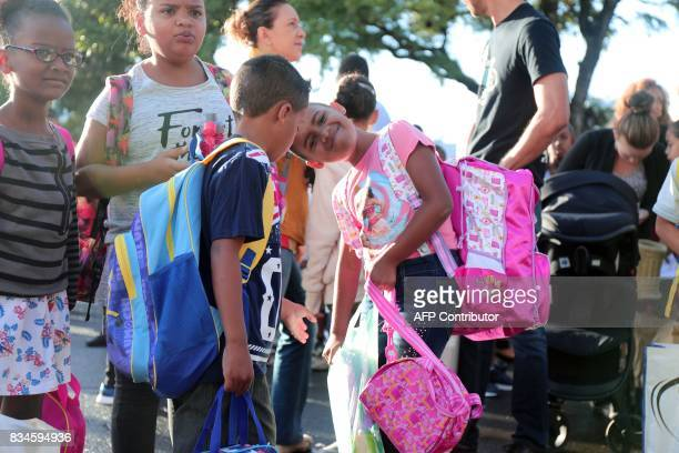 French pupils arrive at Michel Debre elementary school on the first day of the new school year in SaintDenis de la Reunion on the French Indian Ocean...